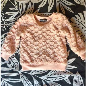 Pink heart sweater.